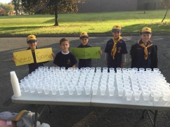 Cub Scouts from Pack 263 supporting runners in the NPEF's 5K Strides for Students race.