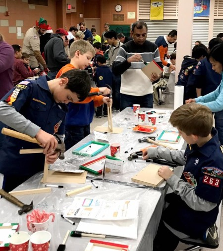 Cub Scouts and parents spent their evening building and painting toys and decorations to donate throughout the community.